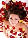 Beautiful girl in rose petal. Royalty Free Stock Photo