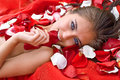 Beautiful girl in rose petal Royalty Free Stock Photo