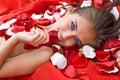 Beautiful girl in rose petal Royalty Free Stock Photo