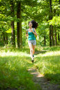 Beautiful girl running through forest Royalty Free Stock Photo