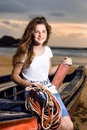 Beautiful girl  sailor posing in boat at the coast Royalty Free Stock Images