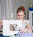 Beautiful girl sewing Stock Image