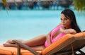 Beautiful girl in a bikini on the beach Royalty Free Stock Photo