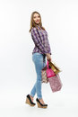 Beautiful girl with shoping bsgs  isolated Royalty Free Stock Photo