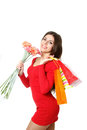 Beautiful girl shopping bags bouquet gerberas Stock Photo