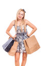 Beautiful girl shopping blond holding bags isolated on white background Royalty Free Stock Images
