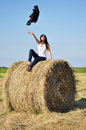 Beautiful girl sit on haystacks young woman Royalty Free Stock Images