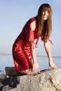 Beautiful girl sits on a rock Royalty Free Stock Images