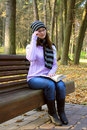 Beautiful girl sitting on a bench Royalty Free Stock Images