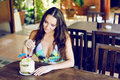 Beautiful girl sitting in a cafe with coconut cocktail Royalty Free Stock Photo