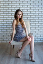 Beautiful girl sitting on a couch Royalty Free Stock Photo