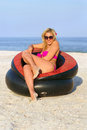 Beautiful girl sitting in an inflatable chair Royalty Free Stock Images