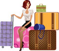 Beautiful girl sitting on a suitcase Royalty Free Stock Photo