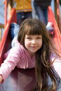 Beautiful Girl on Slide Royalty Free Stock Photography