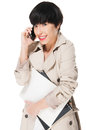 Beautiful girl smiling while using cellphone Royalty Free Stock Photo