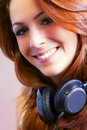 Beautiful girl smiling and listening to music. Royalty Free Stock Photo
