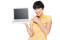 Beautiful girl smiling while using laptop studio shot isolated on white Stock Images