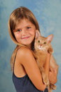 Beautiful girl with somali kitten portrait seven years old in swimsuit fawn color looking at camera Royalty Free Stock Photo