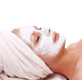 Beautiful girl with spa mask on face Stock Photography