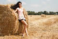 Beautiful girl on a stack of hay Royalty Free Stock Images