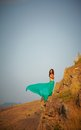 Beautiful girl standing on a precipice. Stock Image