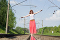Beautiful girl standing on the rails Royalty Free Stock Photo