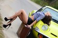 Beautiful girl stands near to car yellow Stock Photos