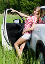 The beautiful girl stands near to white car Royalty Free Stock Image