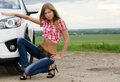 The beautiful girl stands near to white car Stock Images