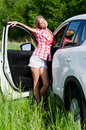 The beautiful girl stands near to white car Stock Photography