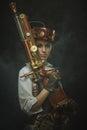 Beautiful girl steampunk in arms.
