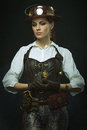 Beautiful girl steampunk. Posing with the clock Royalty Free Stock Photo