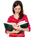 Beautiful girl student reading a book Royalty Free Stock Images