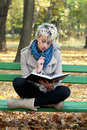 Beautiful girl studying outdoors Royalty Free Stock Photography