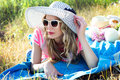 Beautiful girl sunbathing on nature in a hat Royalty Free Stock Photo
