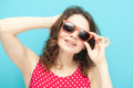 Beautiful girl in sunglasses on a blue background soft focus Royalty Free Stock Photos