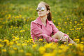 Beautiful girl with sunglasses in dandelion field young Royalty Free Stock Photos