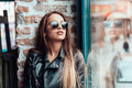 Beautiful girl in sunglasses posing on camera Royalty Free Stock Photo