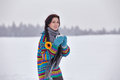 Beautiful girl in a sweater on a winter walk with a cup of tea Royalty Free Stock Photo