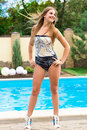 Beautiful girl at swimming pool Royalty Free Stock Photography