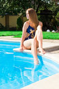 Beautiful girl at swimming pool Royalty Free Stock Photo