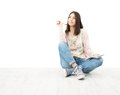 Beautiful girl teenager thinking sitting on floor. Royalty Free Stock Photo
