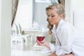 Beautiful girl thoughtfully looks at glass of wine young close up Royalty Free Stock Image