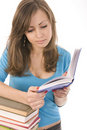 Beautiful girl thoughtfully reading a book Royalty Free Stock Image