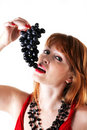 Beautiful girl tries to eat grapes Stock Photo