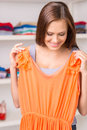 Beautiful girl trying dress and smiling. Royalty Free Stock Photo
