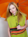 Beautiful girl with umbrella in a warm jacket Royalty Free Stock Photography