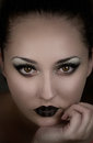Beautiful girl vampire demon witch mysterious woman fantasy book cover with night makeup Stock Photo