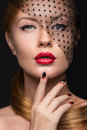 Beautiful girl with a veil evening makeup black and red nails design manicure beauty face picture taken in the studio Royalty Free Stock Image