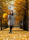 Beautiful girl vertical photo happy with autumnal leaf in park Stock Photo